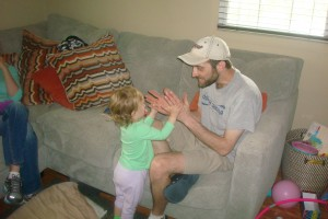 Mike Conover, getting a lesson in clapping from Mabel